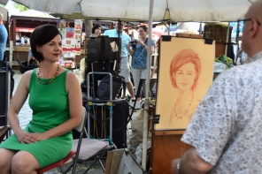 Having my portrait drawn in Place du Tertre
