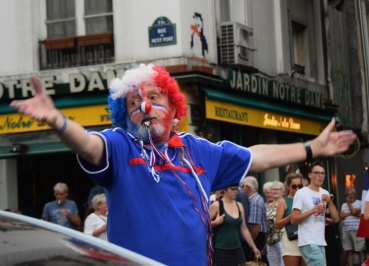 A clown conducts the crowd in cheers