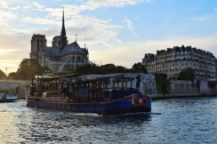 Le Calife sails past Notre Dame cathedral